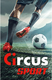 Circus Sport - footballer's legs going to kick a football on a pitch